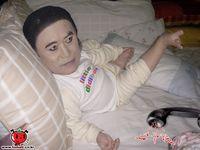 Le poupon André Kim, livré avec son bavoir